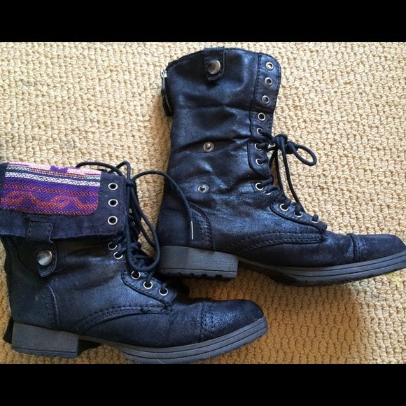 Black combat boots Black combat boots with tribal print detail that can be rolled down!great condition, only worn a few times! Zipper up the back and laces in the front Shoes Combat & Moto Boots
