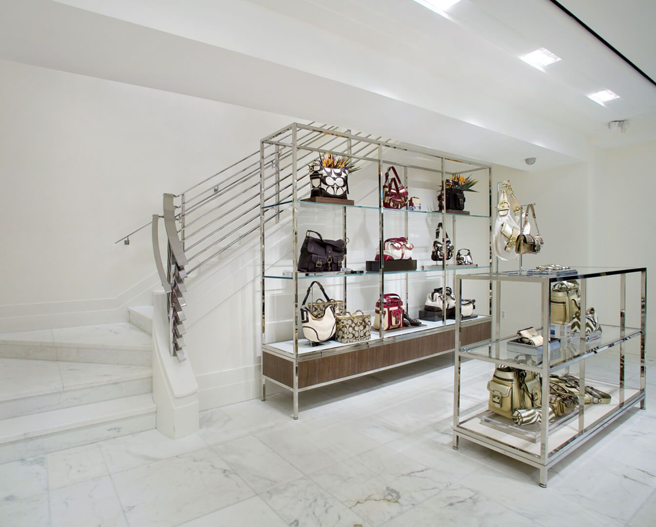 Coach stores by dhd architecture interior design retail store design counter neutral colors purses shelving display modern design