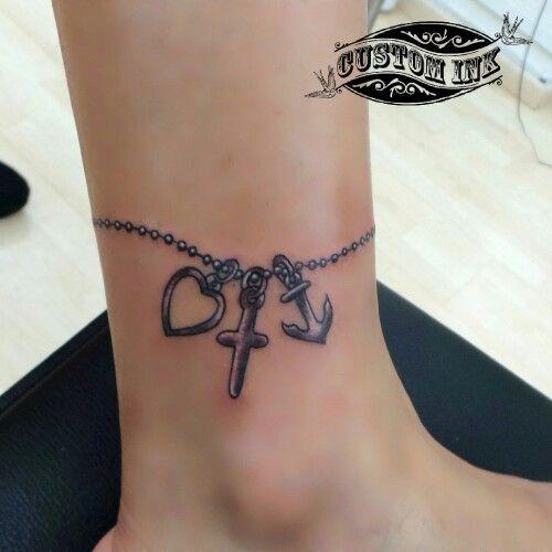 Tattoo Artist Serch / Heart, cross and anchor bracelet tattoo / By Custom Ink