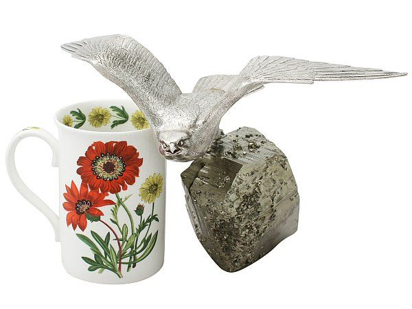 'Silver Bird Ornament' An exceptional, fine and impressive vintage Elizabeth II English cast sterling silver kestrel ornament with an iron pyrite base.