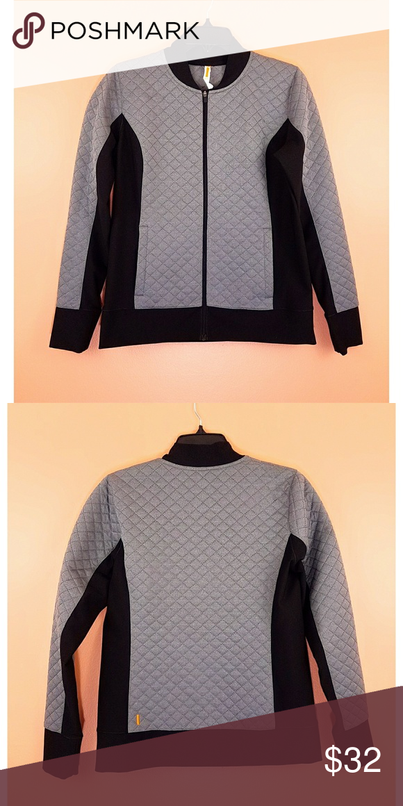Lucy Workout Jacket VGUC jacket from Lucy. Grey and black jacket. Grey area is quilted while black area is smooth. Side pockets. In very good condition, no pilling. Body 1: 100% polyester. Body 2: 88% polyester, 12% spandex lycra. Size S. Approx measurements: 19in bust; 25in length Lucy Jackets & Coats