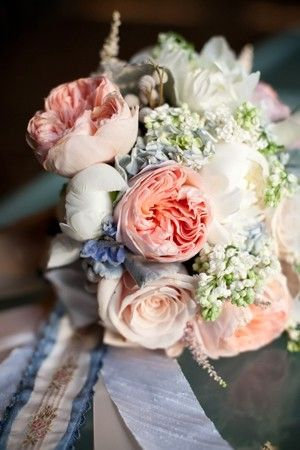 Blue and peach bouquets with blue/white ribbon. Beautiful muted colors!