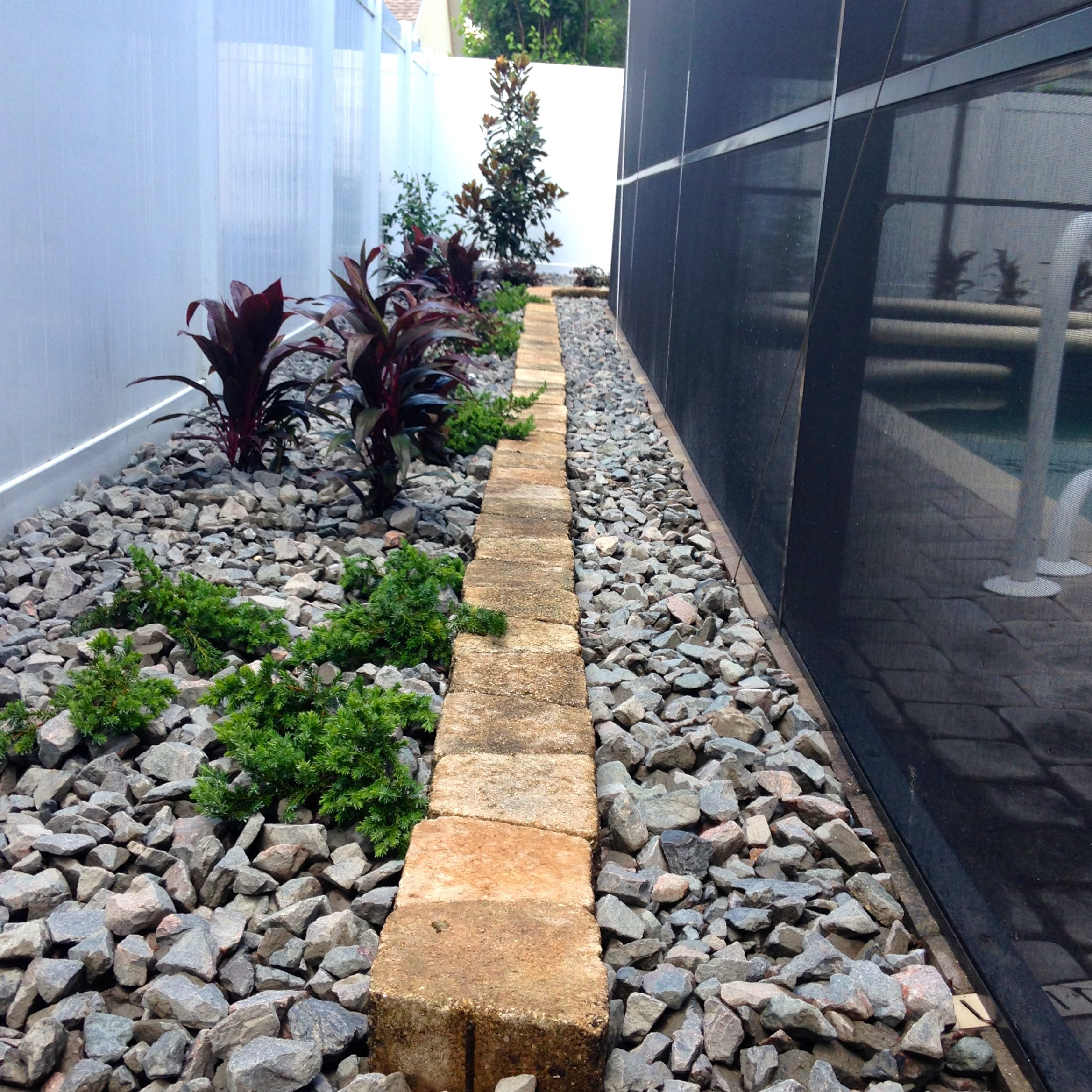 terrace and stones over french drain to resolve runoff flooding