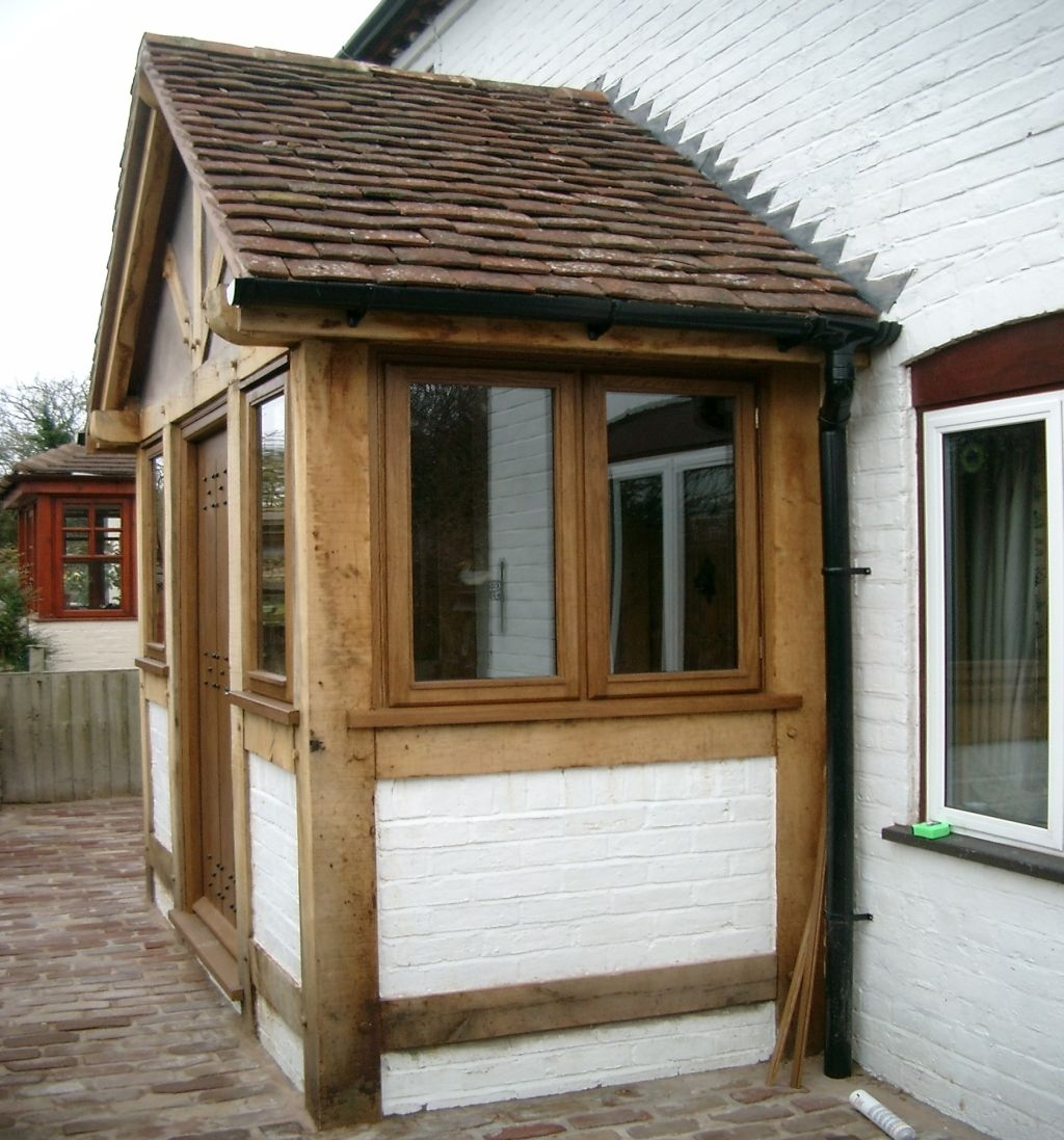 The Side View Of The Green Oak Porch Illustrated Above