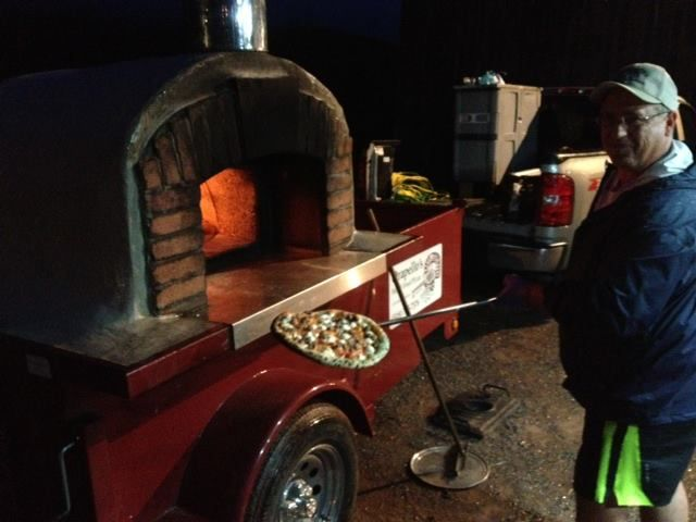 Joe from Orapella's Wood Fired Pizza cooking up some delicious pizza at Inky and Kevin's rehearsal dinner. At Stone Tavern Farm.