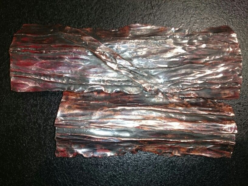 Tree bark made of copper all hand hammered.