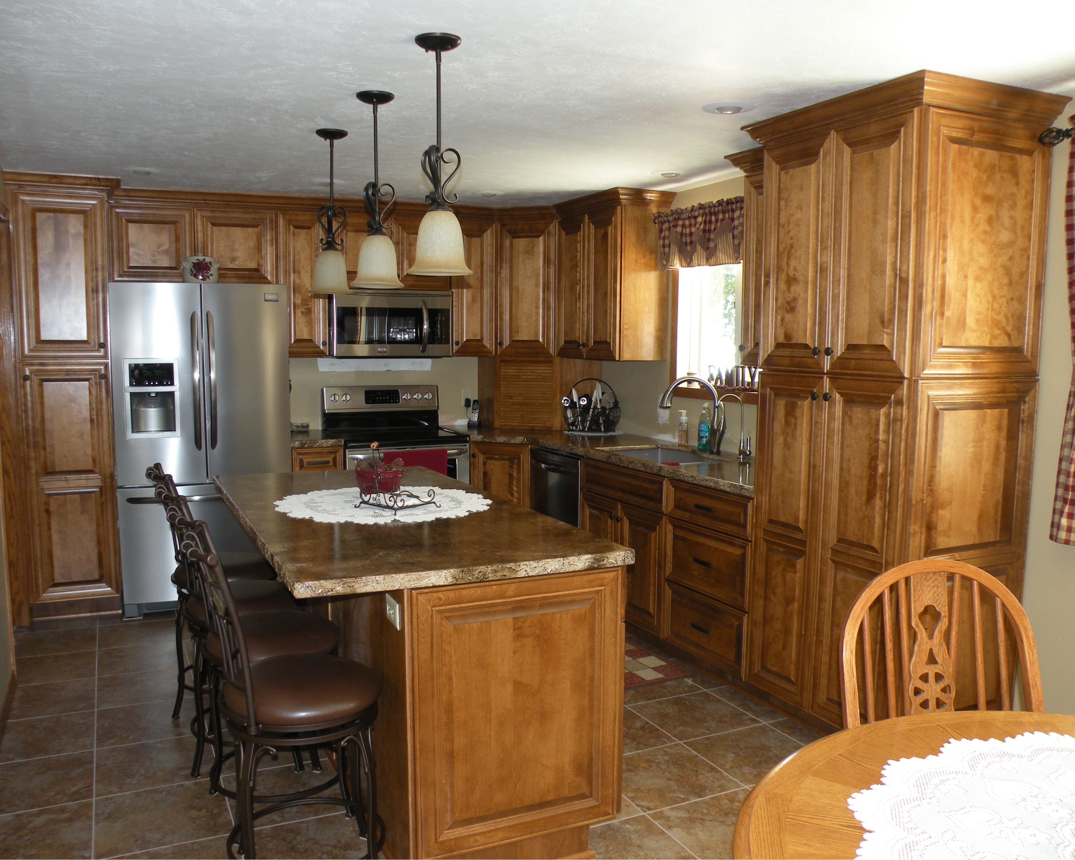 Birch cabinets, raised panel doors, with medium brown ...