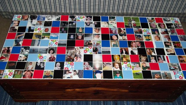 Someone had put this cedar chest to the curb because the top was a mess...used photos and scrapbook paper to create a mosaic!
