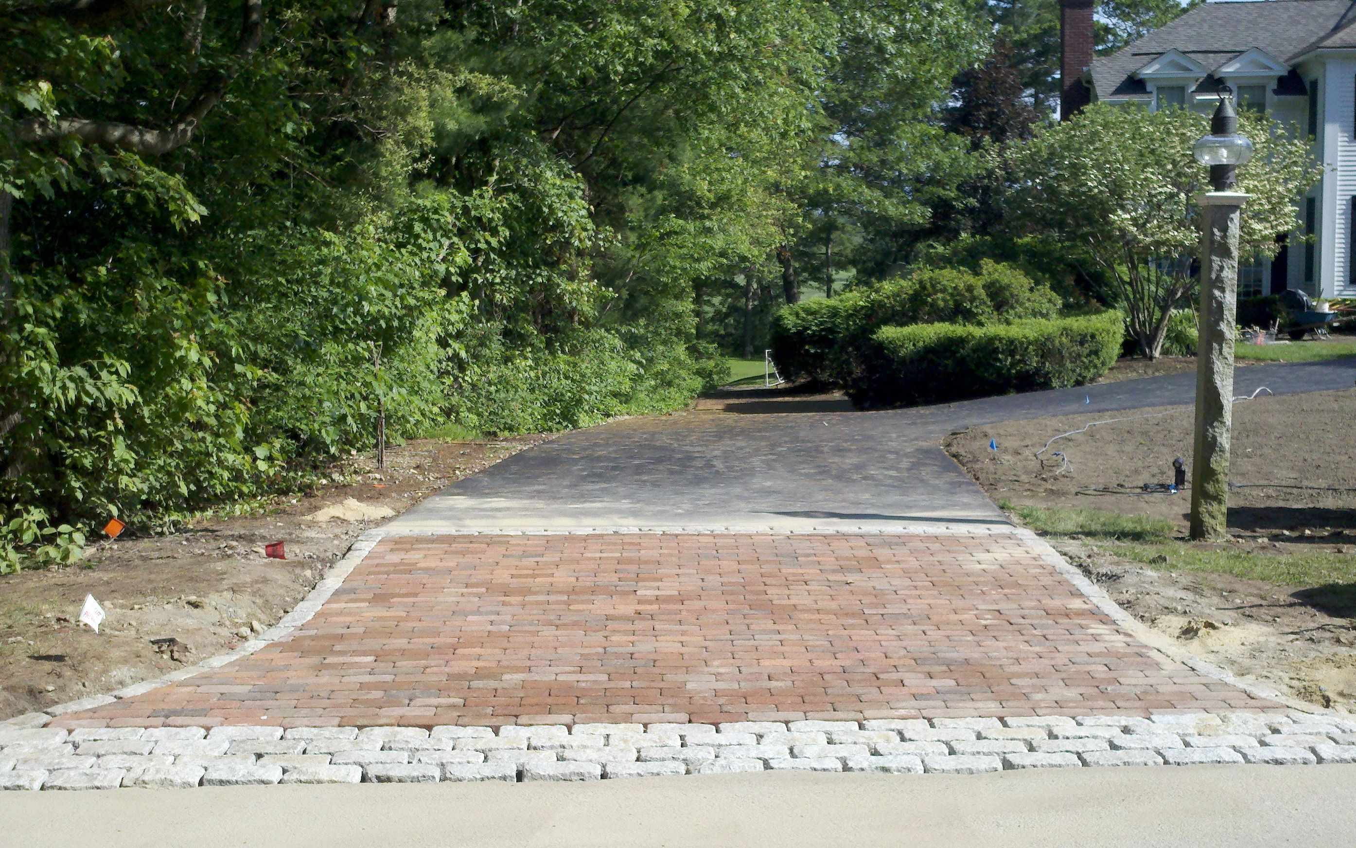 This is a driveway apron we built with cobblestone brick for Driveway apron ideas