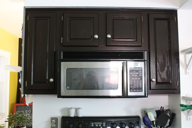 Kitchen Cabinets Java Color refinished kitchen cabinets make appliances blend right in. | home