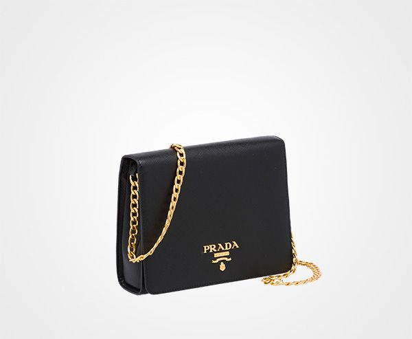 9af47577bfdd Saffiano leather Metal chain shoulder strap Brass-toned hardware Metal  lettering logo Small mirror underneath the flap One inside pocket Nappa  leather ...