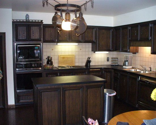 Classic Designed Kitchen Interior Design With Dark Brown Color Of Dark Wood  Material Of Kitchen Furniture
