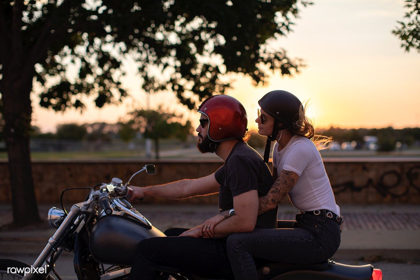 Download Premium Photo Of Biker Couple Riding Down The Road In The