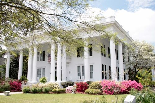 Spring flowering azaleas are in fine form putting on quite a show in front of this gorgeous mansion in Eufaula, Alabama
