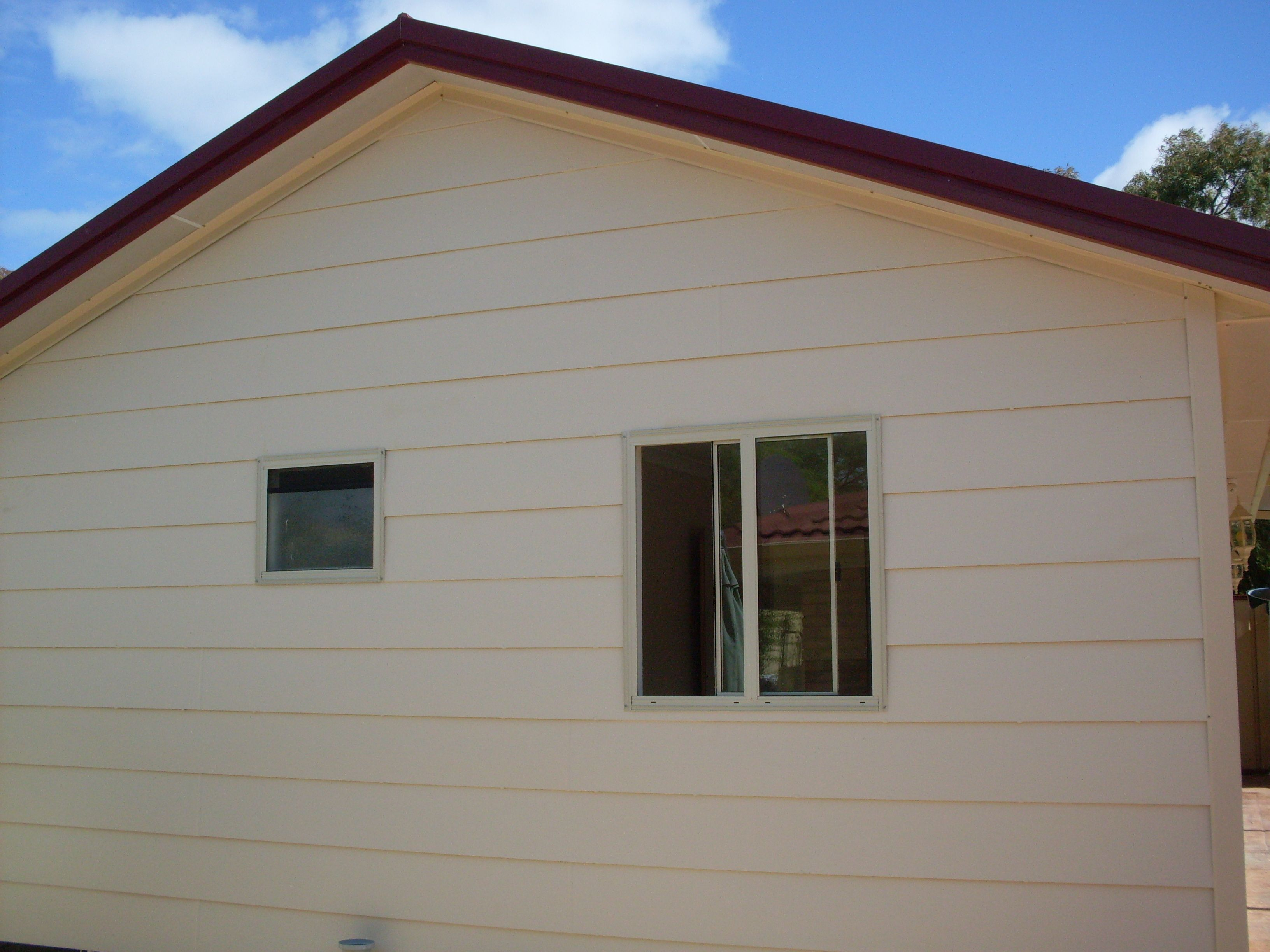 woodgrain hardiplank gable end of building of granny flat only at