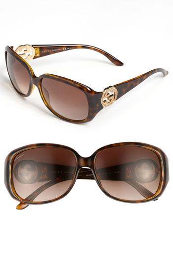 cfcd6da5bc Crystals encrust the logo hinges of classically shaped Italian sunglasses  furnished with gradient lenses.58mm