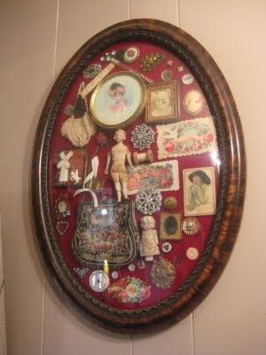An old frame turned into a shadow box of memories, what a great way to display a lot of small mementos!...