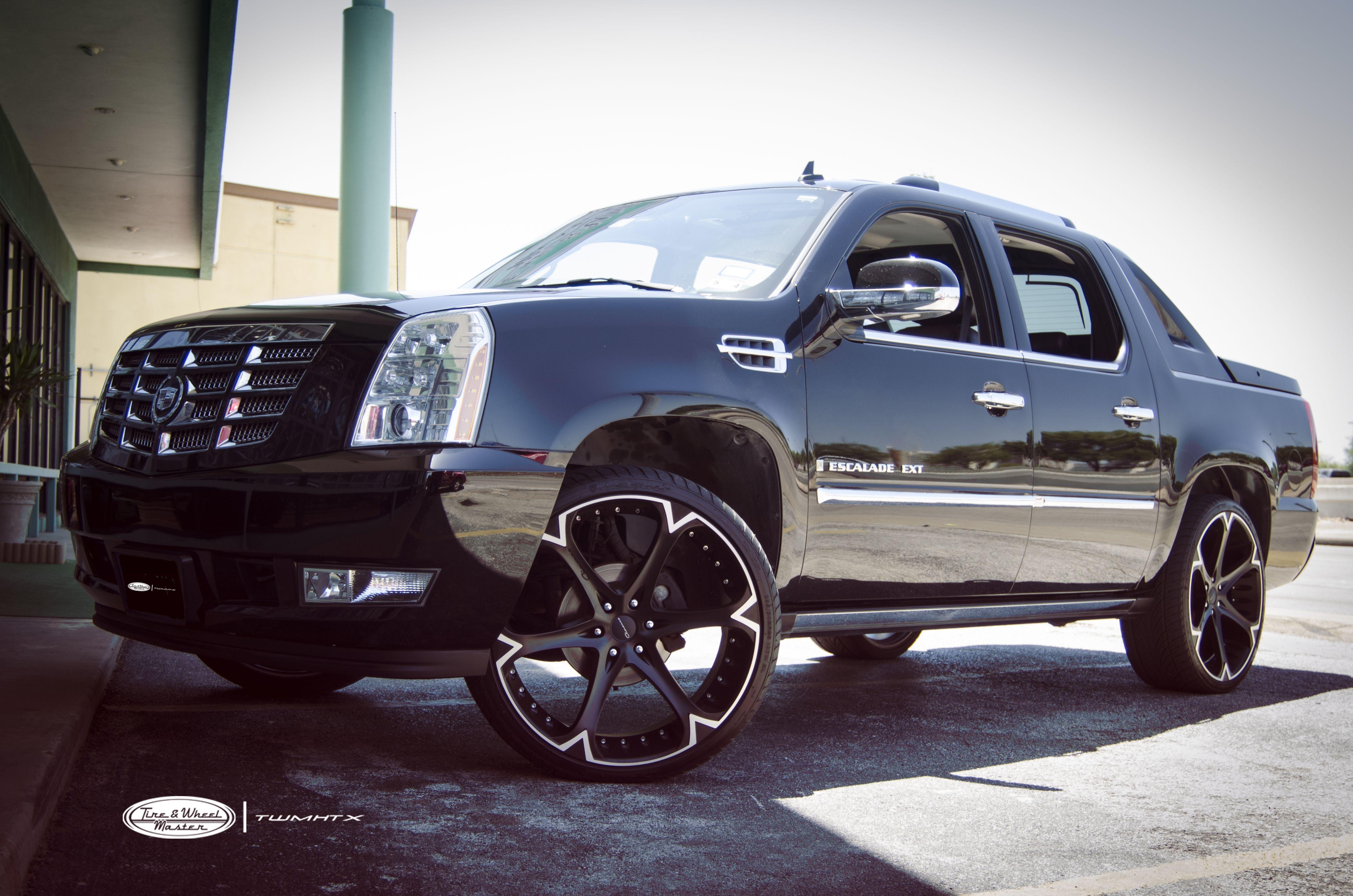 Black cadillac escalade ext with 26 inch giovanna wheels dalar 6v machined black