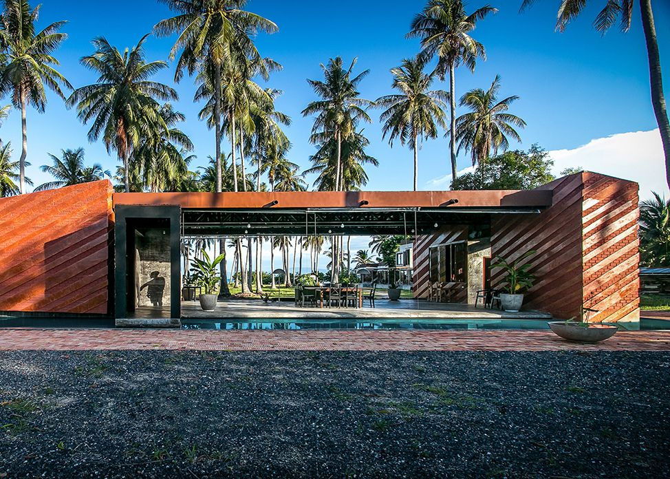 Coconut groves surround NPDA's brick home on a Thai beach