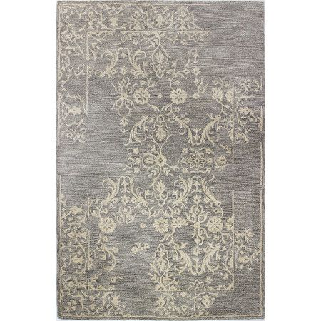 Featuring a weathered floral motif, this hand-tufted wool rug lends a touch of subtle elegance to your entryway or master suite.   P...