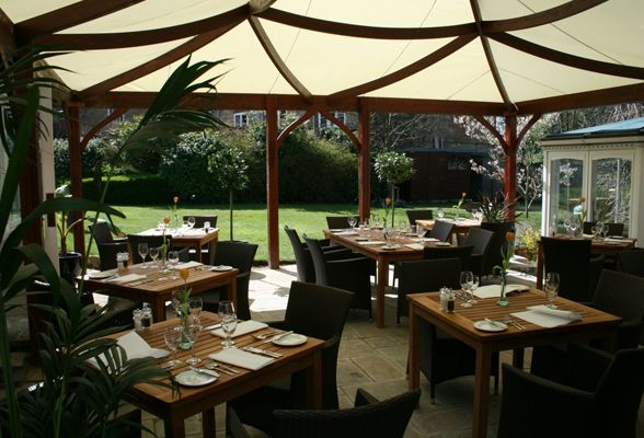 Outdoor Restaurant Seating Under A Tent Canopy In The