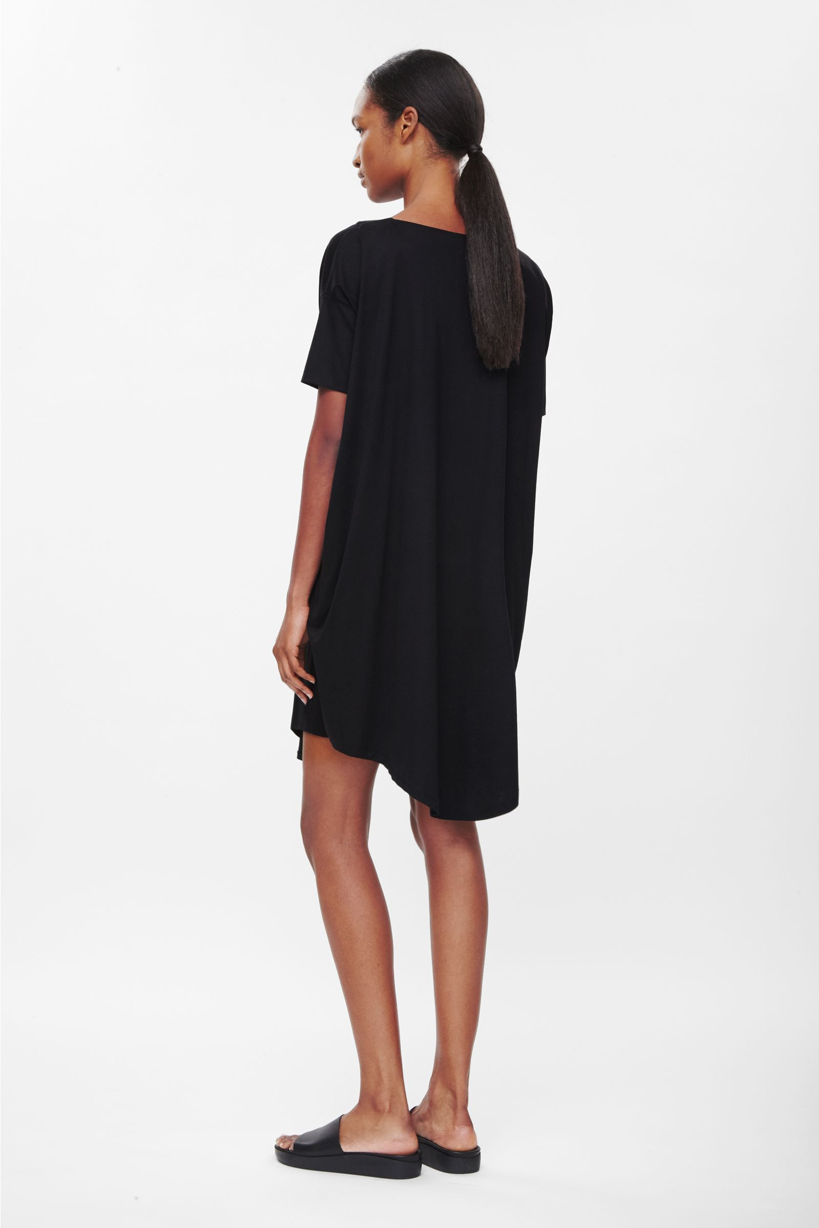 A rounded cocoon shape that tapers towards a curved hemline, this slip-on dress is made from smooth cotton jersey. Designed for everyday wear, it has dropped shoulder seams, square-cut sleeves and in-seam side pockets.