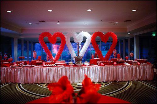 The dessert buffet with balloon heart sculptures