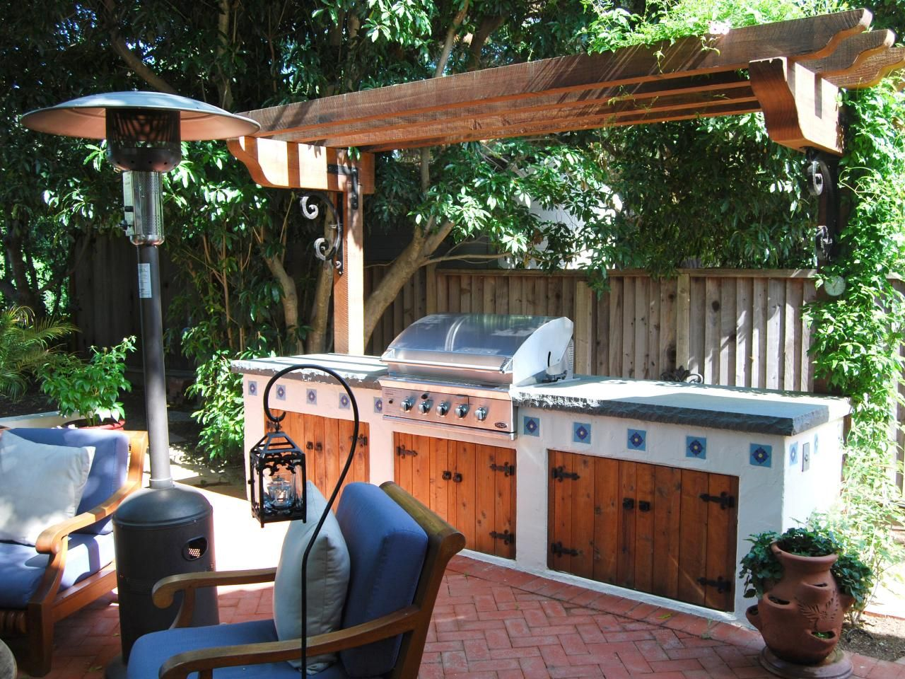 A wooden pergola shades this southwestern style outdoor for Mexican outdoor kitchen designs
