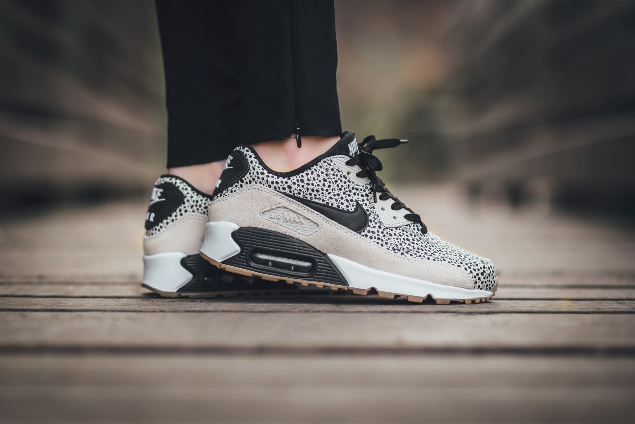 The Nike Air Max 90 Premium is rendered in a WhiteBlack