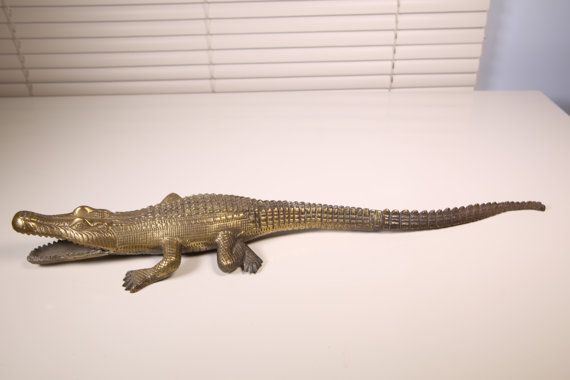 Hello and thank you for looking,  This is brass figurine of a crocodile. it has the original patina and a little dirty but I think it gives him character so Im no messing with him.  18 inches long by 4 1/4 longest side and 1 1/3 inches tall approx.  Its a little dirty so it requires cleaning. Original patina. See photos for general condition and reference.  Questions??? Please let me know.  Mimi