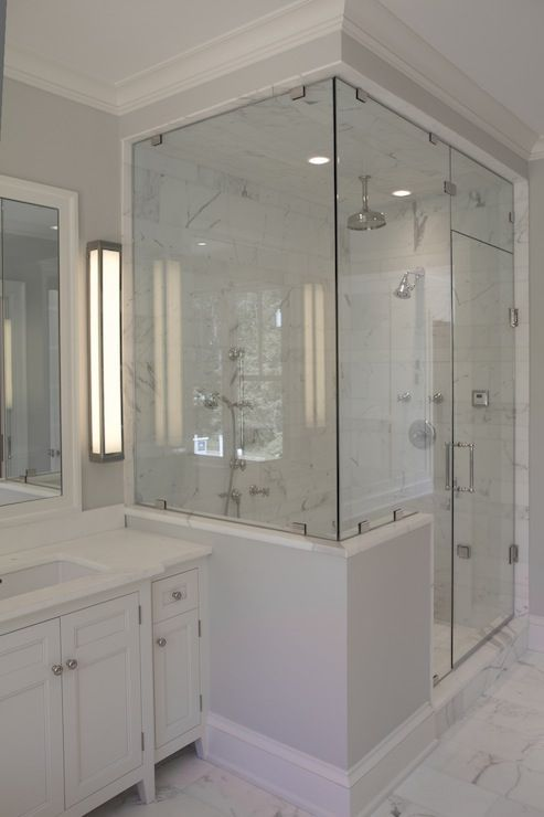 source: Jillian Klaff Homes Master bathroom with cool gray paint color,  seamless glass shower with marble tiles shower surround, polished nickel  rain shower ...