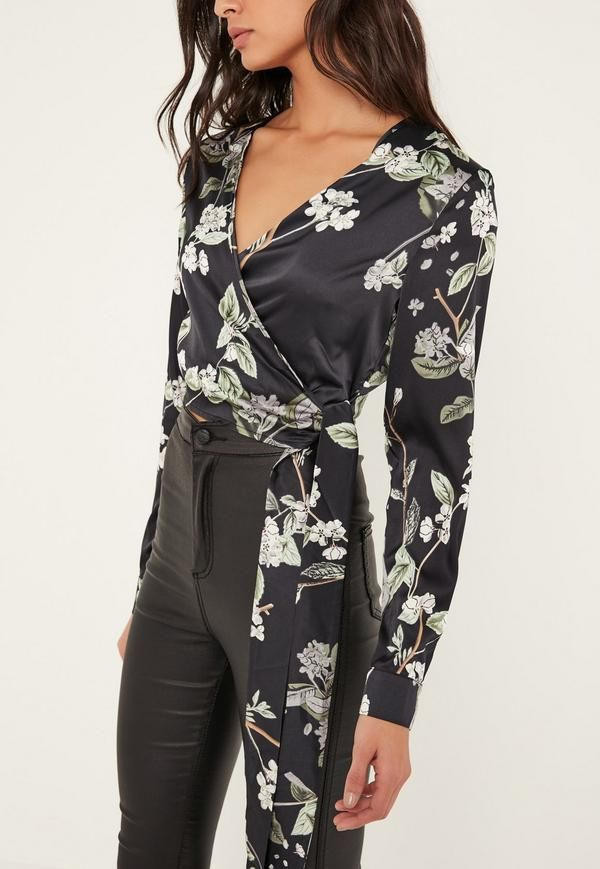 d367dc7737a40 It s a wrap for new season style in this floral print blouse. In a ...