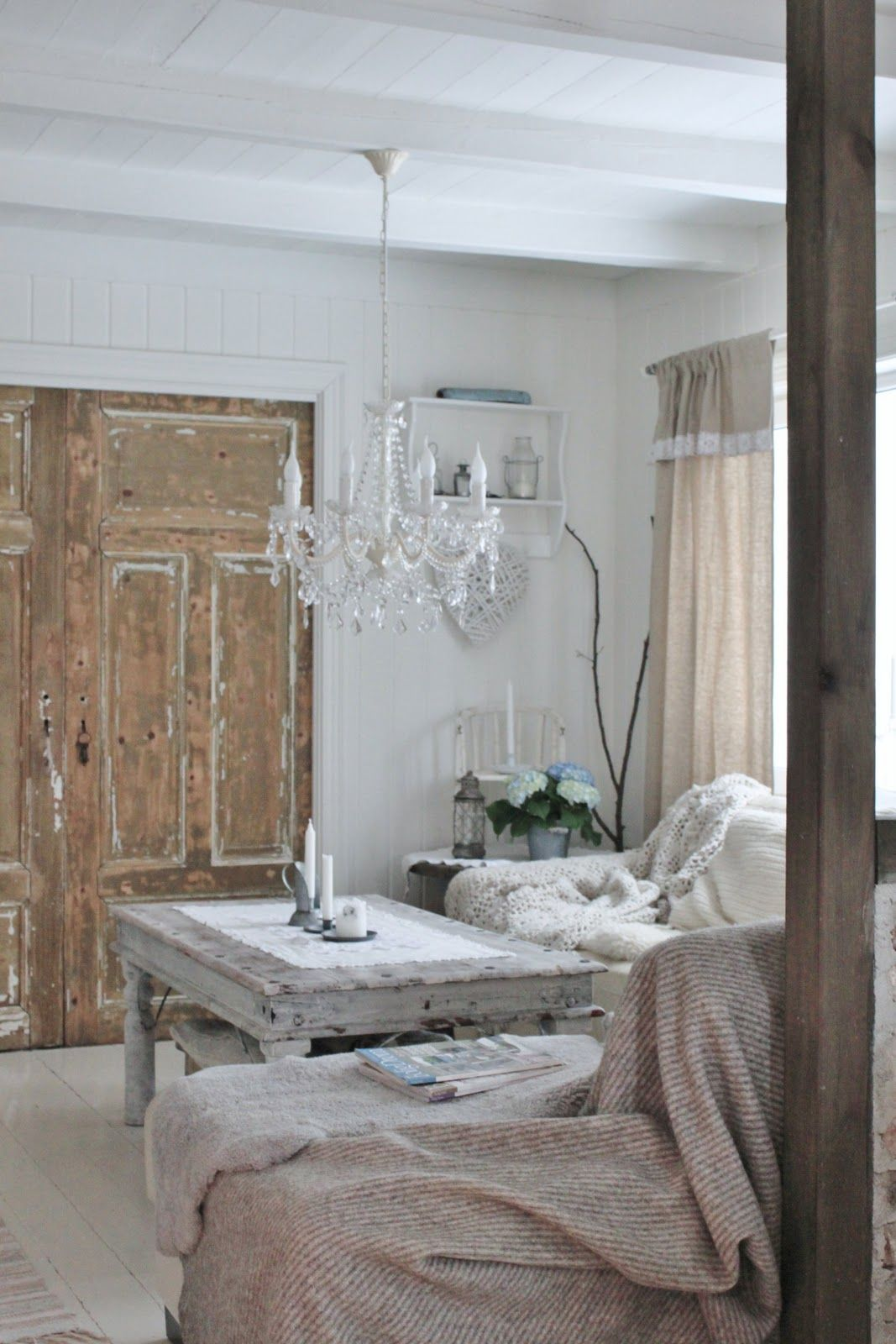 Awesome reclaimed doors and coffee table.