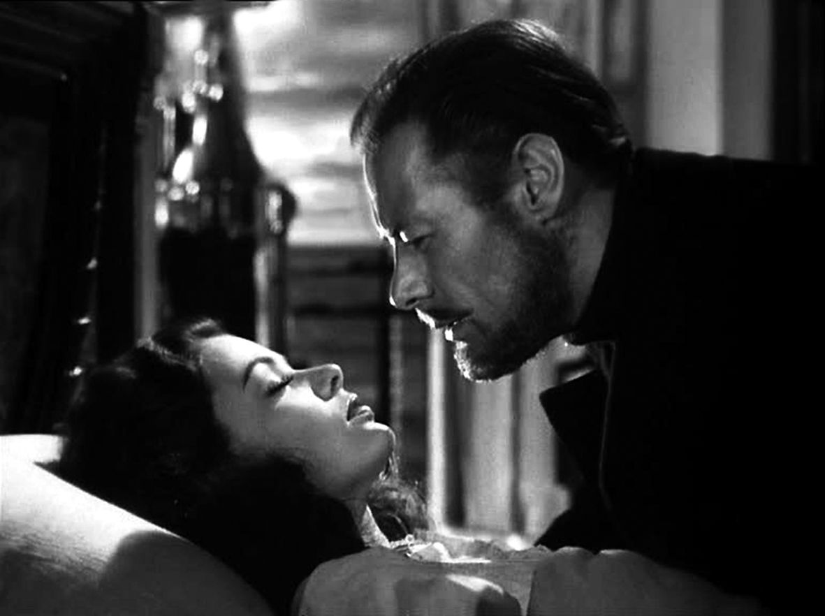The Ghost & Mrs. Muir (1947). Captain Gregg (Rex Harrison) in an intimate moment with a sleeping Lucy Muir (Gene Tierney). Sounds creepy, but it's actually quite beautiful, as is the entire film. It should rank among the most romantic films of the classic era. Fans of black & white will be blown away by the shadows and light here. Gull Cottage itself becomes an unforgettable character. Edna Best as Martha and George Sanders as the naughty Uncle Neddy are outstanding in support. 5 stars.