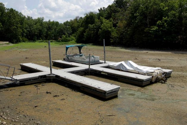 Boats sit on the bottom in a dry cove at Morse Reservoir in Noblesville, Ind., Monday, July 16, 2012. The reservoir is down nearly 6 feet from normal levels and being lowered 1 foot every five days to provide water for Indianapolis. Photo: Michael Conroy / AP