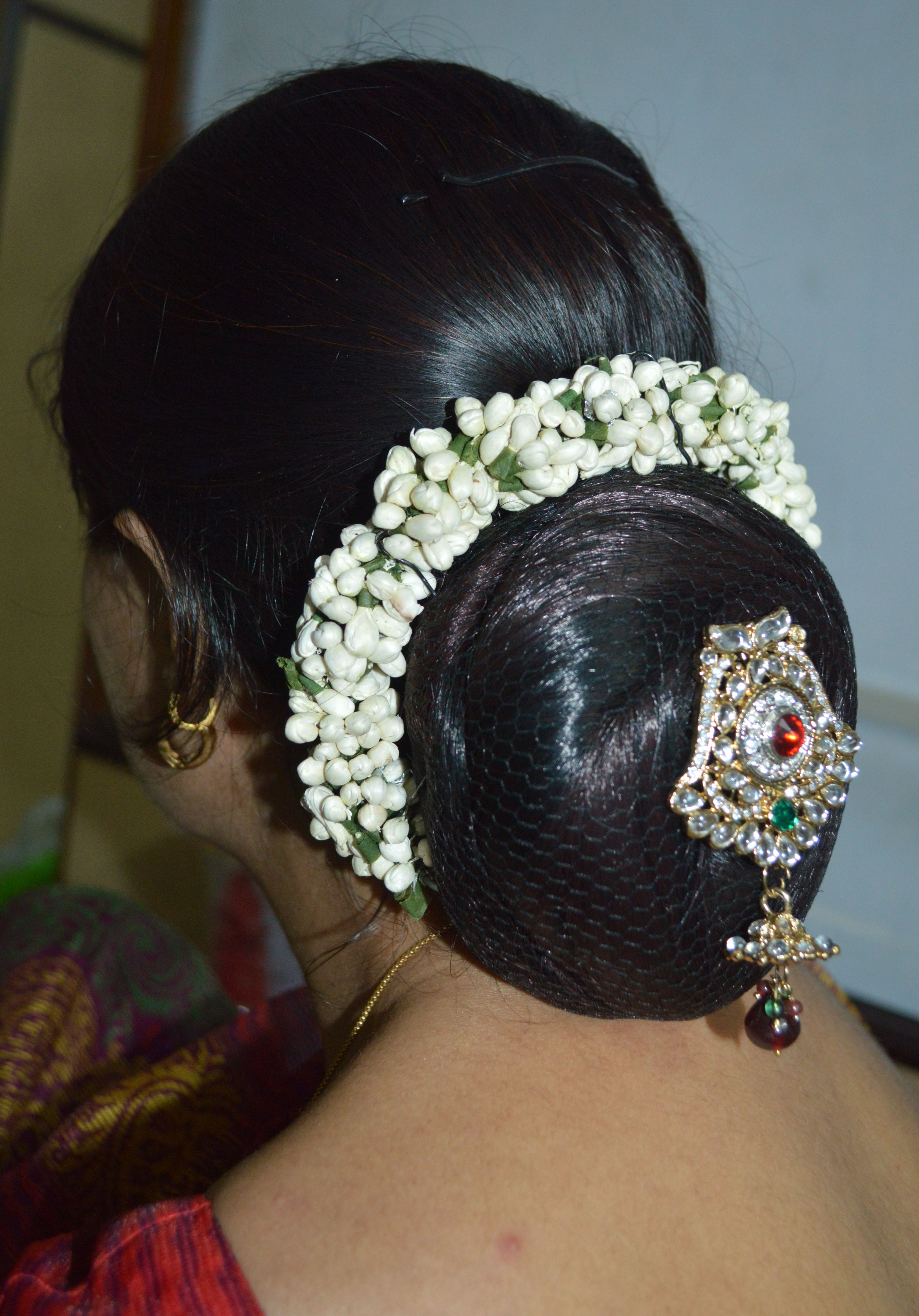 This Beautiful Traditional Low Bun Decorated By A Gajara Of