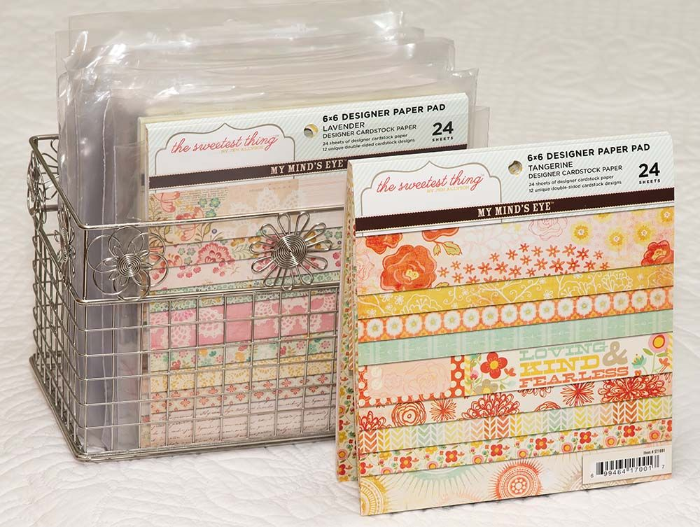 Freezer bags (ziplock cut off) keep paper pads and their scraps together in cute wire baskets from Office Max. DUH moment here! & Freezer bags (ziplock cut off) keep 6x6 paper pads and their scraps ...