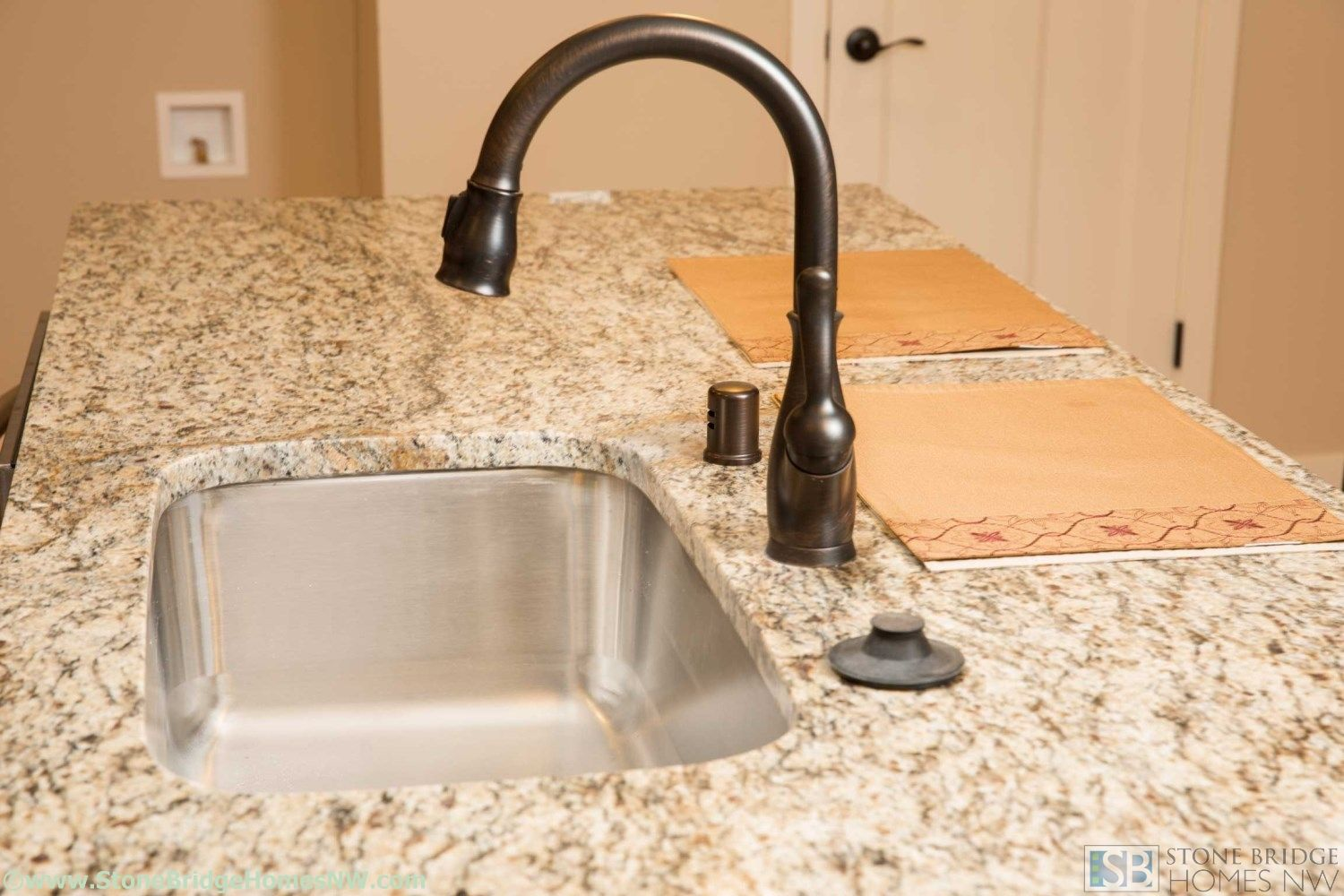 Oil Rubbed Bronze Kitchen Faucet With Stainless Steel Sink And