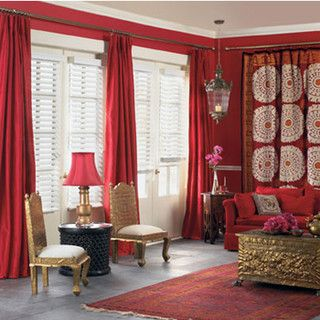 What An Eclectic Room Red Walls Drapes Curtains Redcouch