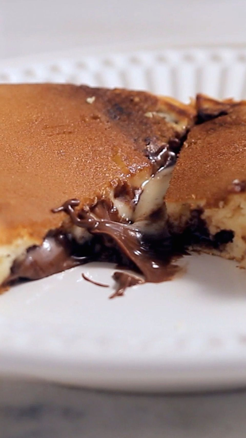 Recipe with video instructions: Nutella Stuffed Pancake recipe Ingredients: 1 cup flour, 2 tablespoons sugar, 2 teaspoons baking powder, ½ teaspoon salt, 1 cup of milk, 2 tablespoons melted butter, 1 egg, ½ cup Nutella, Oil