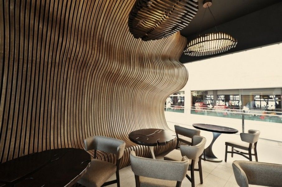 Inspiring Coffee House Idea with Modern Space Theme: Irregular Wooden Shutters In The Innarch Don Cafe House With Rounded Wooden Table And Brown Chairs