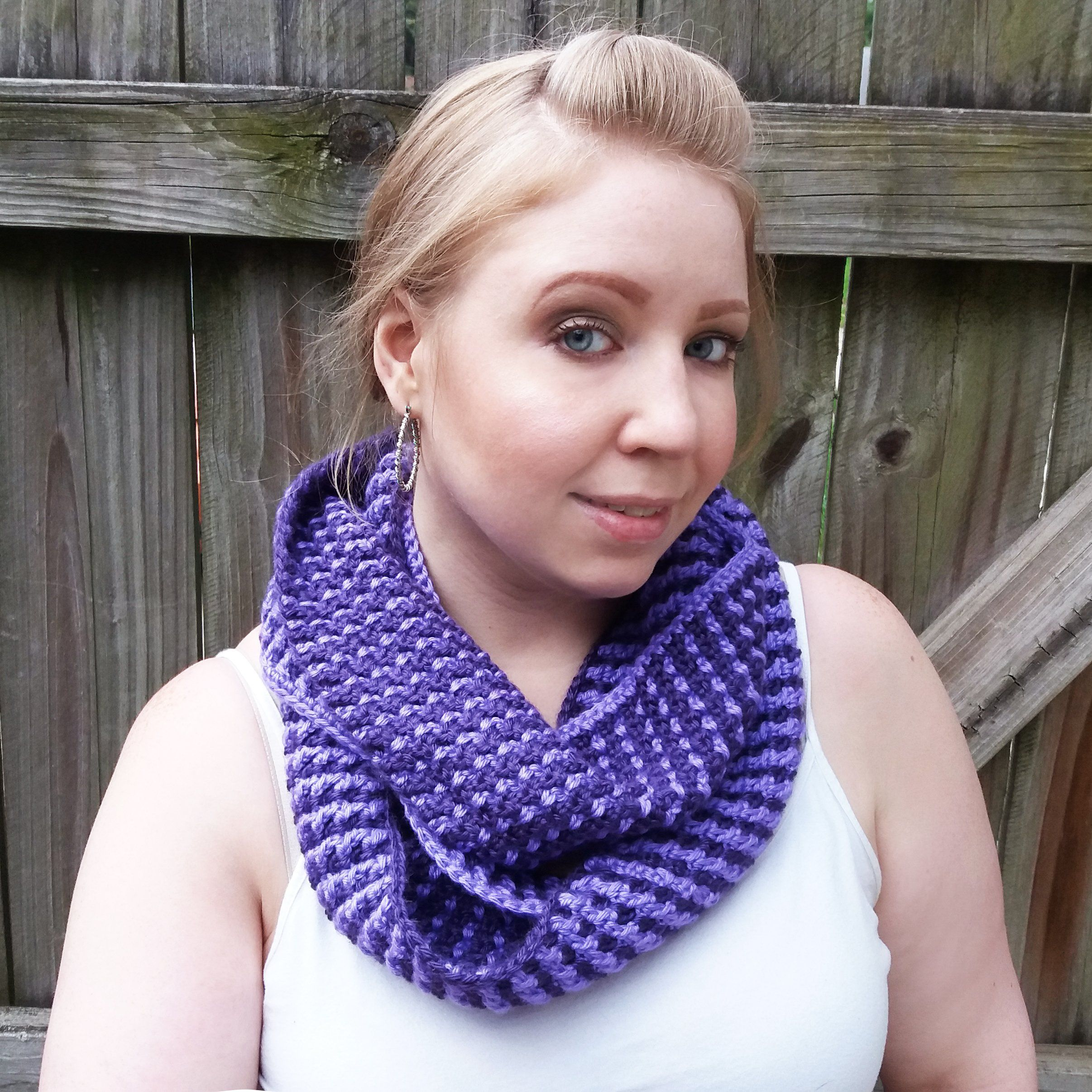 Purple Crochet Infinity Scarf. Add a unique statement piece to your cool weather ensemble with this double-sided crochet infinity scarf. Made with silky acrylic yarn in light and dark purple, each side has a different look that combines beautifully with the other when doubled up. Care Instructions: Hand wash in cool water and lay flat to air dry.