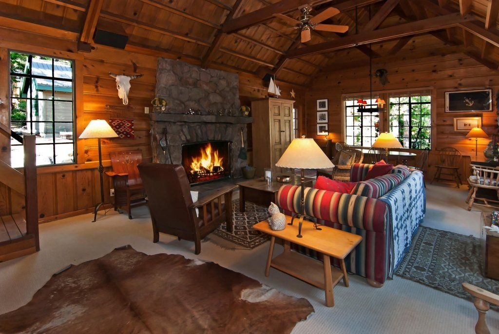 Grand living room with stone fireplace, vaulted beam ...