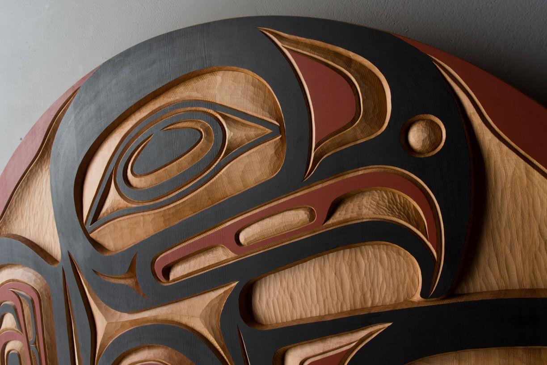 Red cedar and acrylic eagle panel by salish artist Jim Charlie
