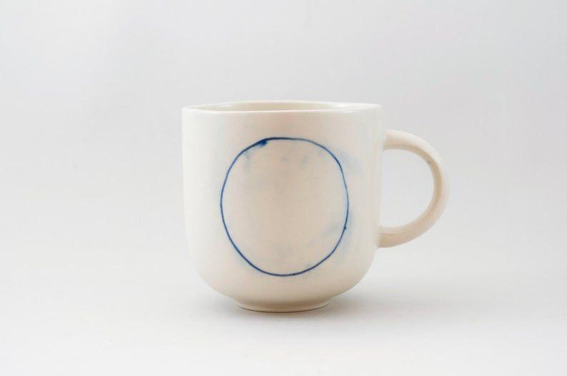 Handmade Ceramic mug with blue circle H: 3″