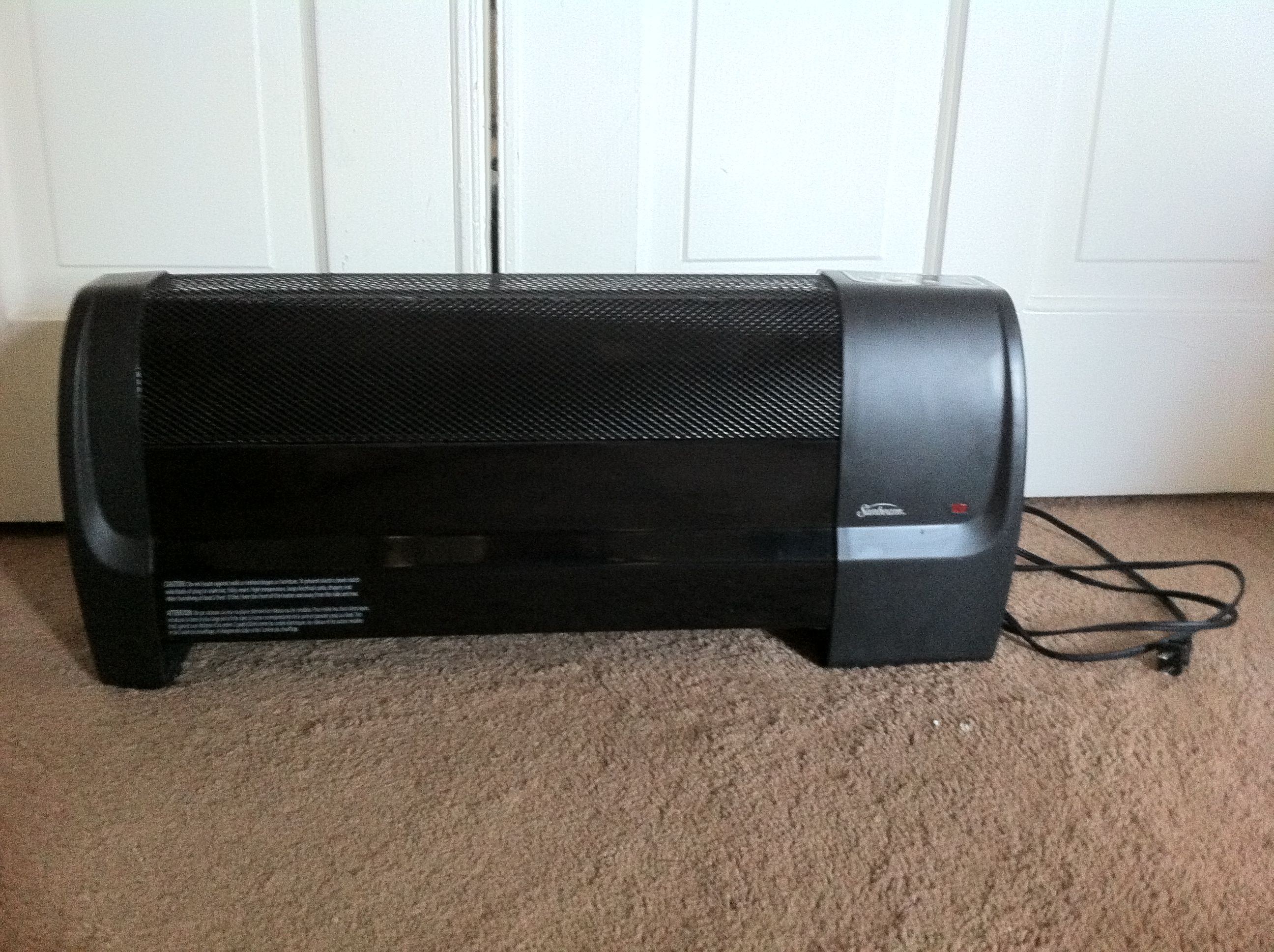 Sunbeam electric heater. Has temperature settings and an off timer. $35  http://www.canadiantire.ca/en/home/heating-air-conditioning/portable-heating/sunbeam-low-profile-convection-heater-0435908p.html?utm_campaign=bazaarvoice&utm_medium=SearchVoice&utm_source=RatingsAndReviews&utm_content=Default#.U4v0vHJdVIE