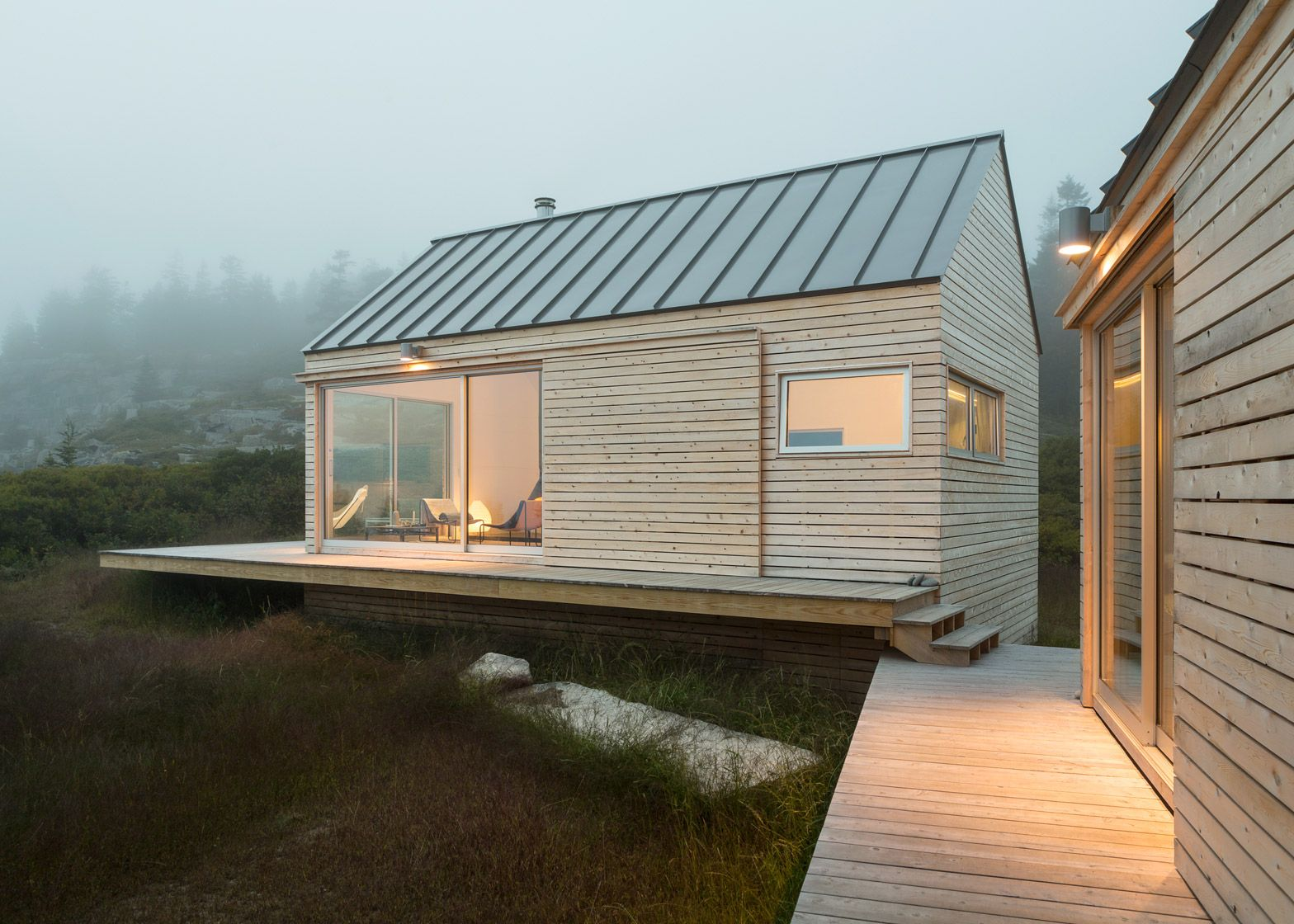 Trio of wooden cabins forms Little House