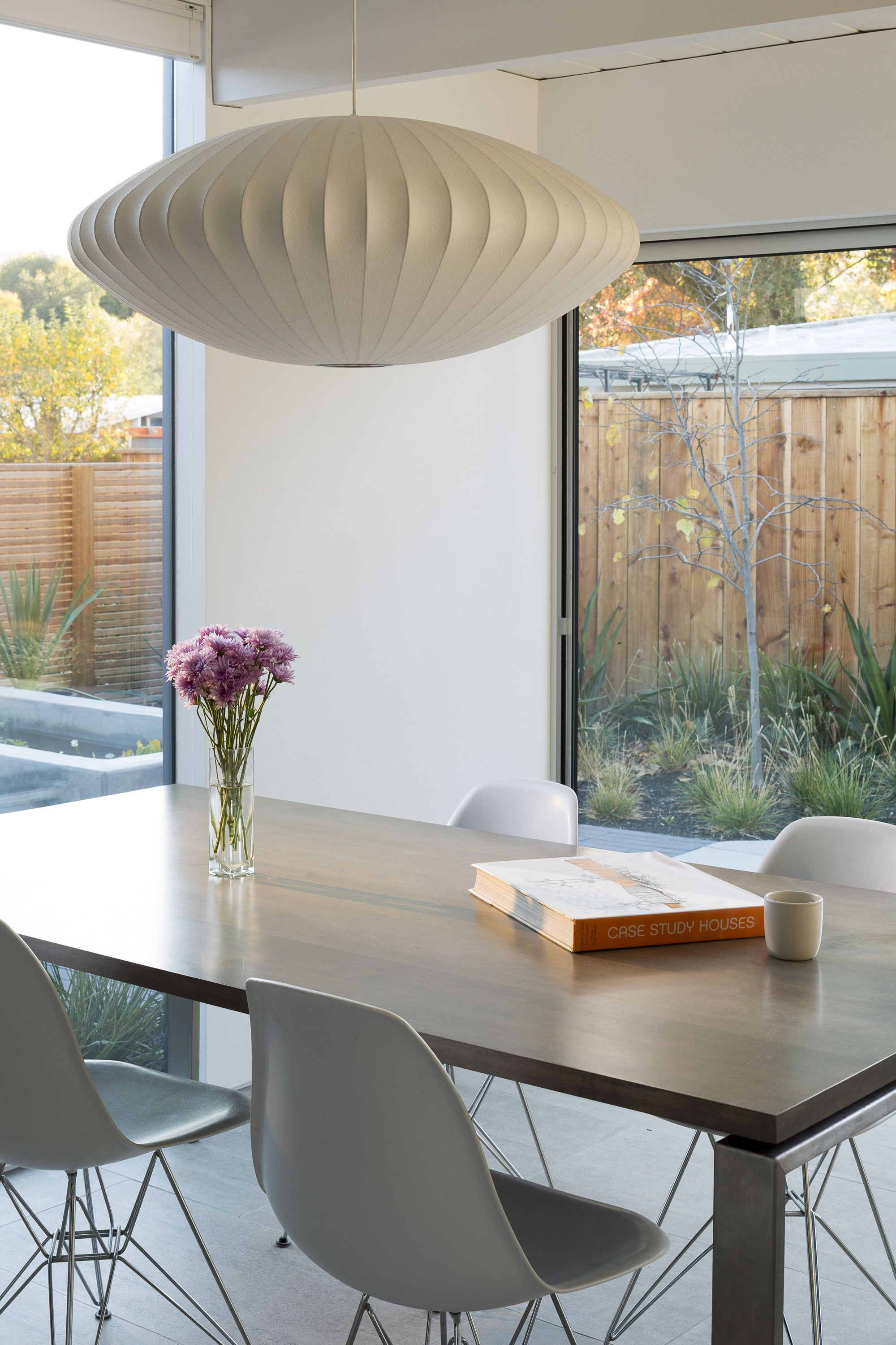 The nelson saucer bubble pendants wide surface area diffuses soft light into any interior it comes with a steel ceiling plate which allows it to