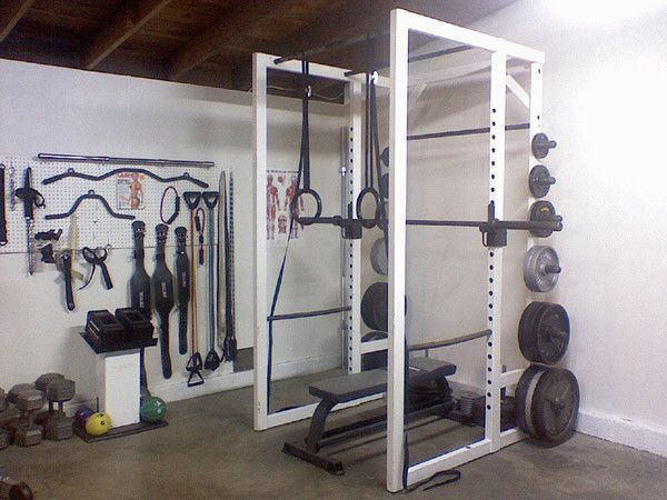 Badass garage gym look at that attachment wall home