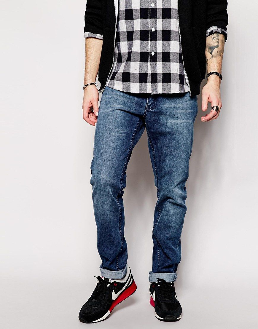 """Jeans by Cheap Monday Firm-stretch denim Mid wash Regular rise Zip fly Tapered leg Slim fit - cut closely to the body Machine wash 68.3% Cotton, 28.3% Polyester, 2.3% Viscose, 1.1% Elastane Our model wears a 81cm/32"""" regular and is 185.5cm/6'1"""" tall"""